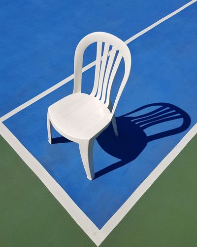 High angle view of chair on tennis court