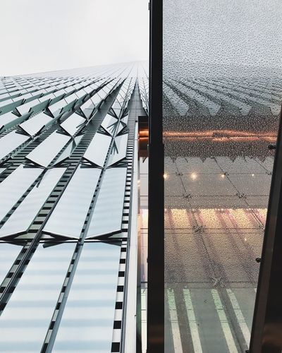 Low angle view of greenhouse against sky