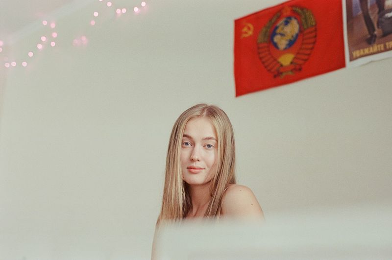 Portrait of a beautiful young woman against wall