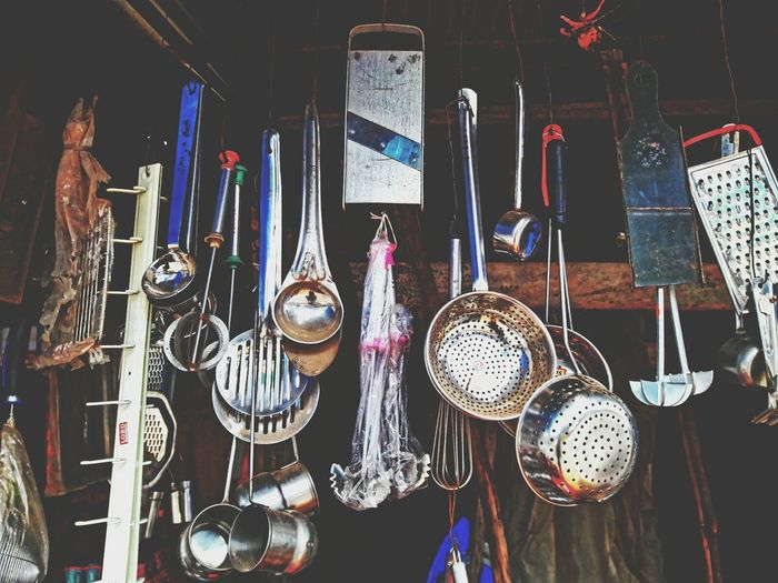 Kitchen utensils hanging for sale at market
