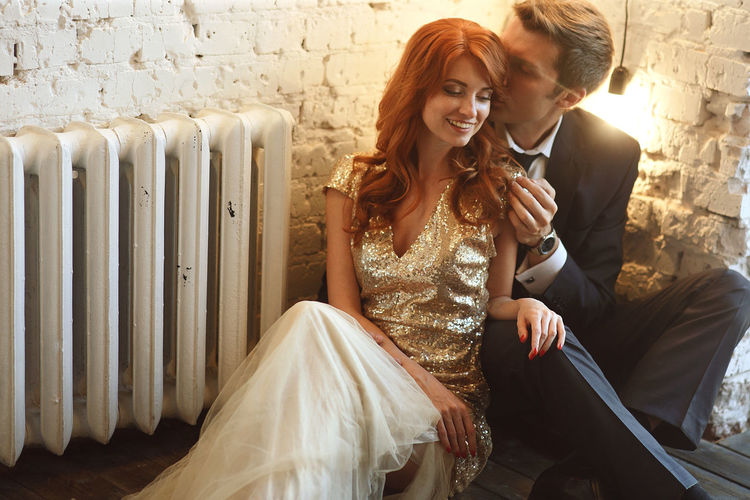 EyeEmNewHere Beautiful Woman Bride Couple - Relationship Evening Gown Formalwear Happiness Heterosexual Couple Indoors  Lifestyles Love Men Real People Romance Sitting Smiling Togetherness Two People Wedding Wedding Dress Well-dressed Women Young Adult Young Men Young Women