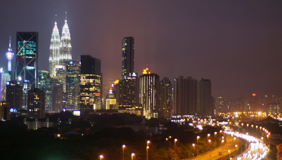 Malaysia city skyline illuminated at night.Blurry photo light and bokeh. Architecture Building Building Exterior Built Structure City City Life Cityscape Financial District  Illuminated Landscape Modern Nature Night Nightlife No People Office Building Exterior Outdoors Residential District Sky Skyscraper Tall - High Tower Urban Skyline