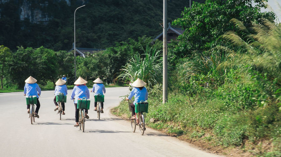 People riding bicycle on road