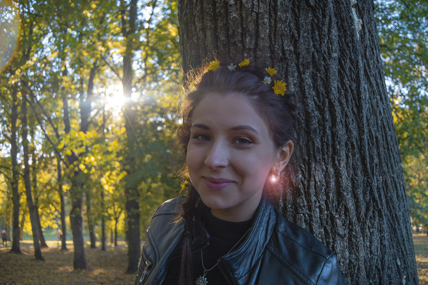 Autumn Portrait Beautiful Woman Forest Hair Hairstyle Headshot Land Leisure Activity Lifestyles Looking At Camera Nature One Person Outdoors Plant Portrait Real People Smiling Sunlight Tree Tree Trunk Trunk WoodLand Young Adult Young Women