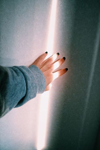 Human Body Part Human Hand Hand One Person Indoors  Body Part Wall - Building Feature Light - Natural Phenomenon Adult Real People Touching Sunbeam Gesturing Men Close-up Finger Sunlight Human Finger Mature Adult Human Limb