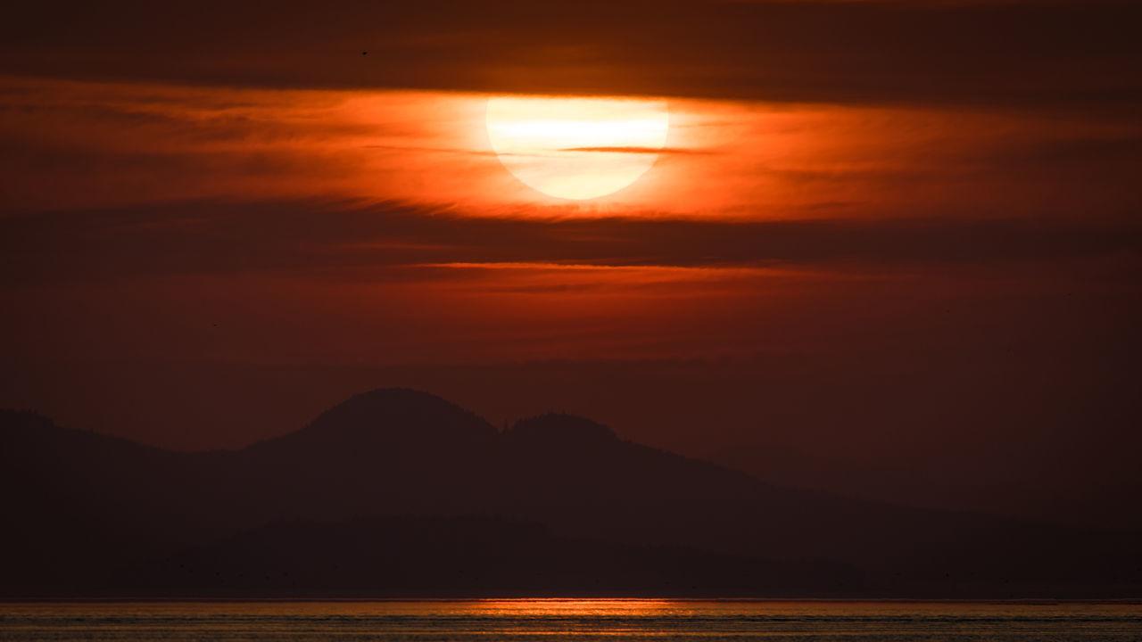 SCENIC VIEW OF SEA AGAINST ROMANTIC SKY