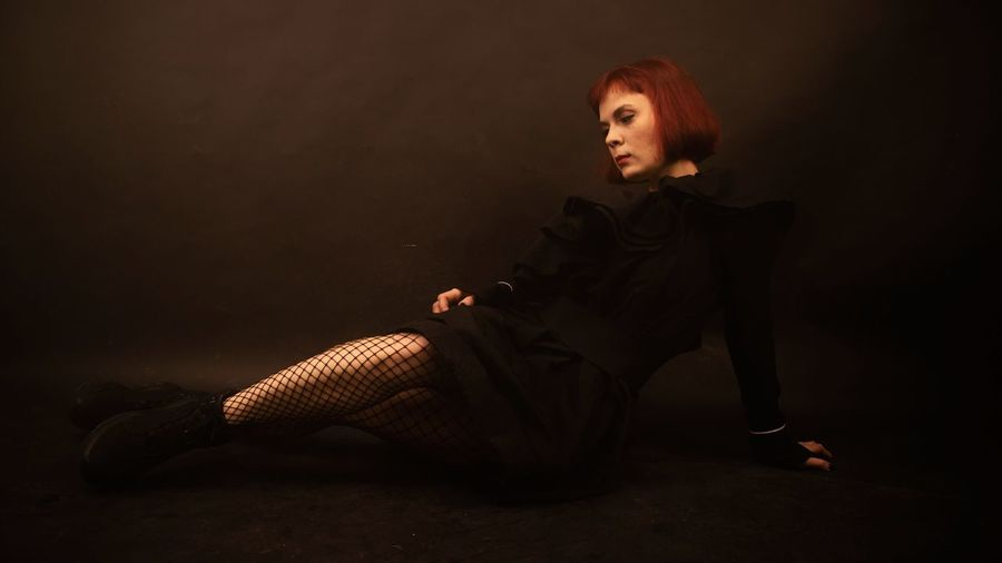 Winter melancholy Saint Petersburg Darkroom Redhead Readhair Style And Fashion Black Outfit Girl Young Women Beatiful Girl Sitting On Floor EyeEm Selects EyeEm Selects EyeEm Gallery EyeEmBestPics Eyeemphotography Editorial Photography Women Portrait Halloween Posing Dyed Red Hair
