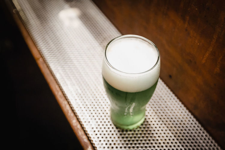 High angle view of beer glass on table