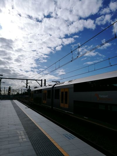 Beware gap when boarding! Railroad Track Railway Public Transportation Sky Transportation Outdoors Day Sydney Train Clouds
