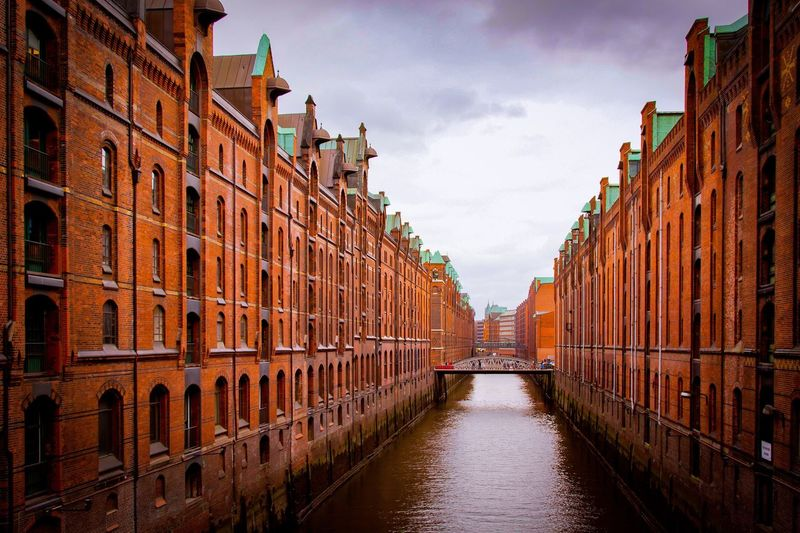 Speicherstadt Hamburger Brick Building Brick Wall Backstein Speicherstadt Hamburg Hamburg Architecture Sky Built Structure Building Exterior Water Nature Cloud - Sky City No People Canal Waterfront Warehouse vanishing point Travel Destinations Building Diminishing Perspective