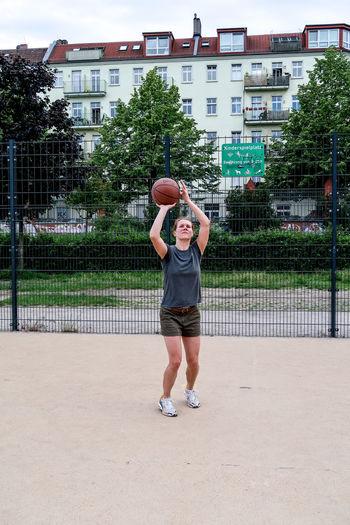 Full Length Of Woman Playing Basketball