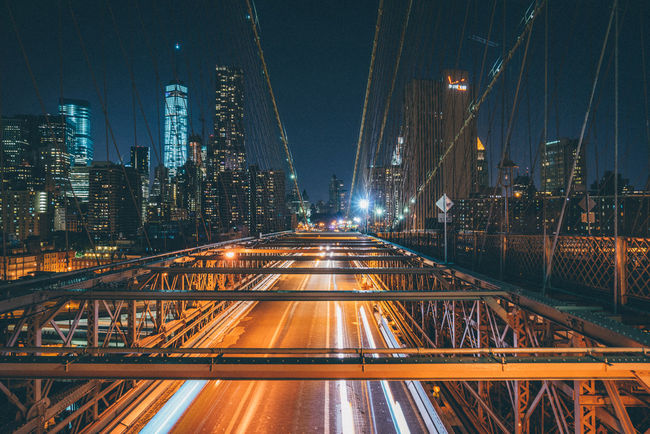 Brooklyn Bridge Brooklyn Bridge  NYC Manhattan Night City Illuminated Cityscape Road Light Trail Bridge - Man Made Structure Skyscraper Long Exposure City Life Architecture Overpass Tail Light Office Building The Traveler - 2018 EyeEm Awards HUAWEI Photo Award: After Dark