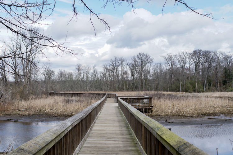 View of bridge over lake against sky