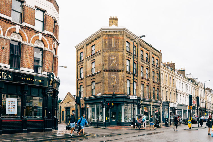 People crossing a Street near Brick Lane in London Architecture Brick Lane Building Building Exterior City City City Life Cityscape Crossing The Street Exterior Façade Hipster London London Trip London_only LONDON❤ Multicultural Perspective Rainy Day Shootermag Shopping Shoreditch Street Traveling Urban