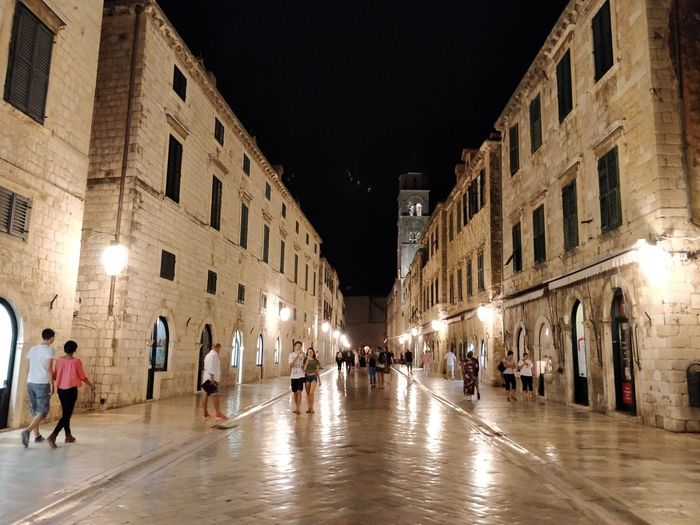Illuminated street in the old town of Dubrovnik Fading In No Filters  City Illuminated Crowd City Street Architecture Building Exterior Built Structure Visiting City Gate Arch