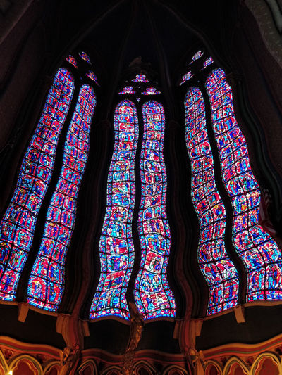 Low angle view of multi colored glass window in temple