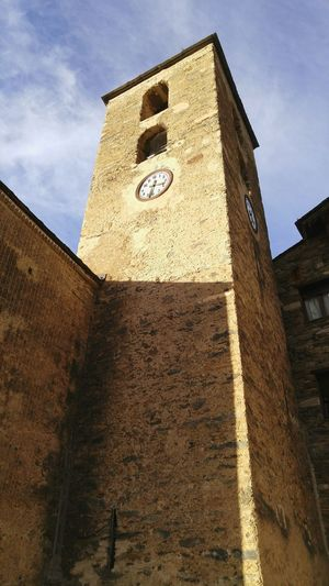 The clock tower of the church of Ordino, Andorra Architecture Low Angle View Sky Archival Built Structure Building Exterior Clock Day Outdoors History No People Europe_gallery Clock Tower Save The Clock Tower Churchtower Church Architecture Europe Ordino