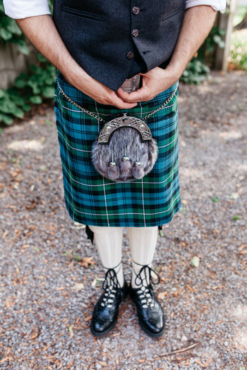 Low Section Of Man Wearing Kilt