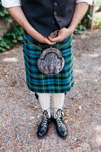 Low Section Of Man Wearing Kilt