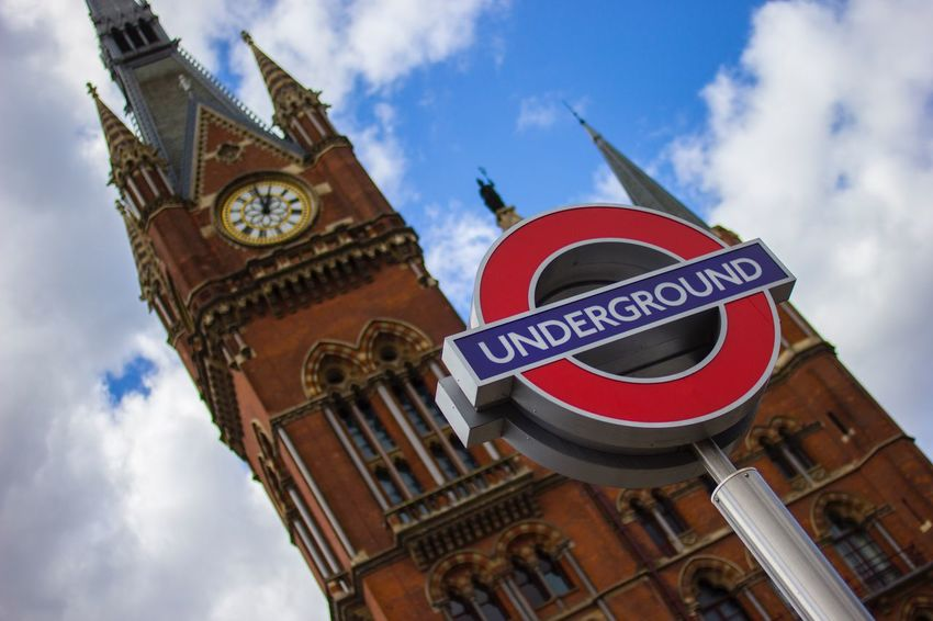 St Pancras International station, London EyeEmNewHere King's Cross St Pancras East Midlands Trains Shallow Depth Of Field London Underground Sign London Underground London St Pancras Station St Pancras Gothic Architecture Low Angle View Sky Building Exterior Cloud - Sky Built Structure Clock Tower Tower Clock No People Day City
