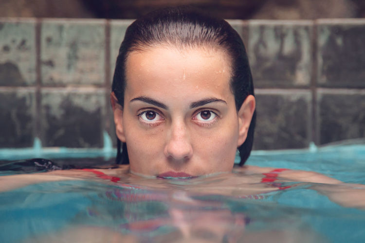 Beautiful Woman Body Part Close-up Front View Headshot Human Body Part Human Face Indoors  Leisure Activity Lifestyles Looking At Camera One Person Pool Portrait Real People Swimming Swimming Pool Water Young Adult