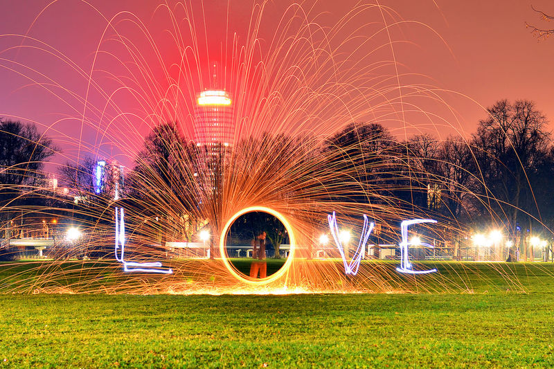 Light painting of love text in park at dusk