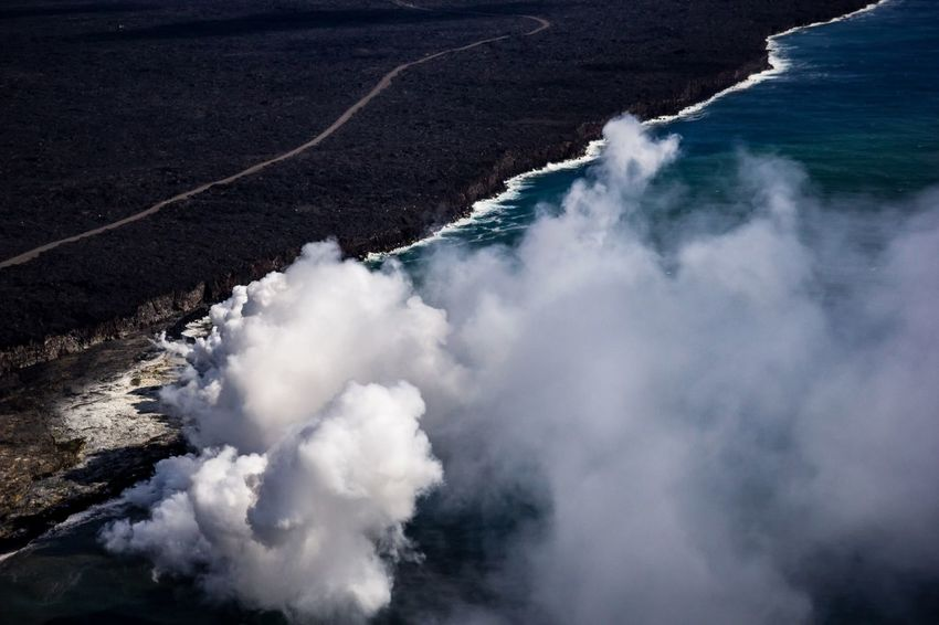 Lava into the ocean 🌋🌊 Hawaii Life Hawaii Volcano Kilauea Kilauea Volcano Eruption Erupting Vog Water Sea Beach Nature Beauty In Nature Day No People Land High Angle View Motion Wave Outdoors Non-urban Scene Power In Nature Smoke - Physical Structure