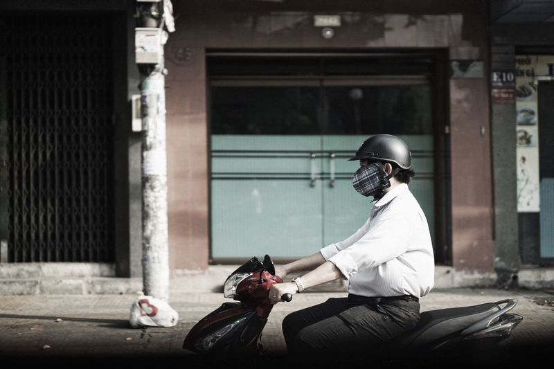 Rear view of man riding motorcycle