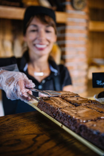 Female Shop Assistant Selling Brownies Brownie Chocolate Sweet Cake Food Brown Dessert Delicious Tasty Bakery Sugar Baked Slices Close Up Pieces Cocoa Black Sweet Food Saleswoman Selling Small Business Desert Gourmet Product