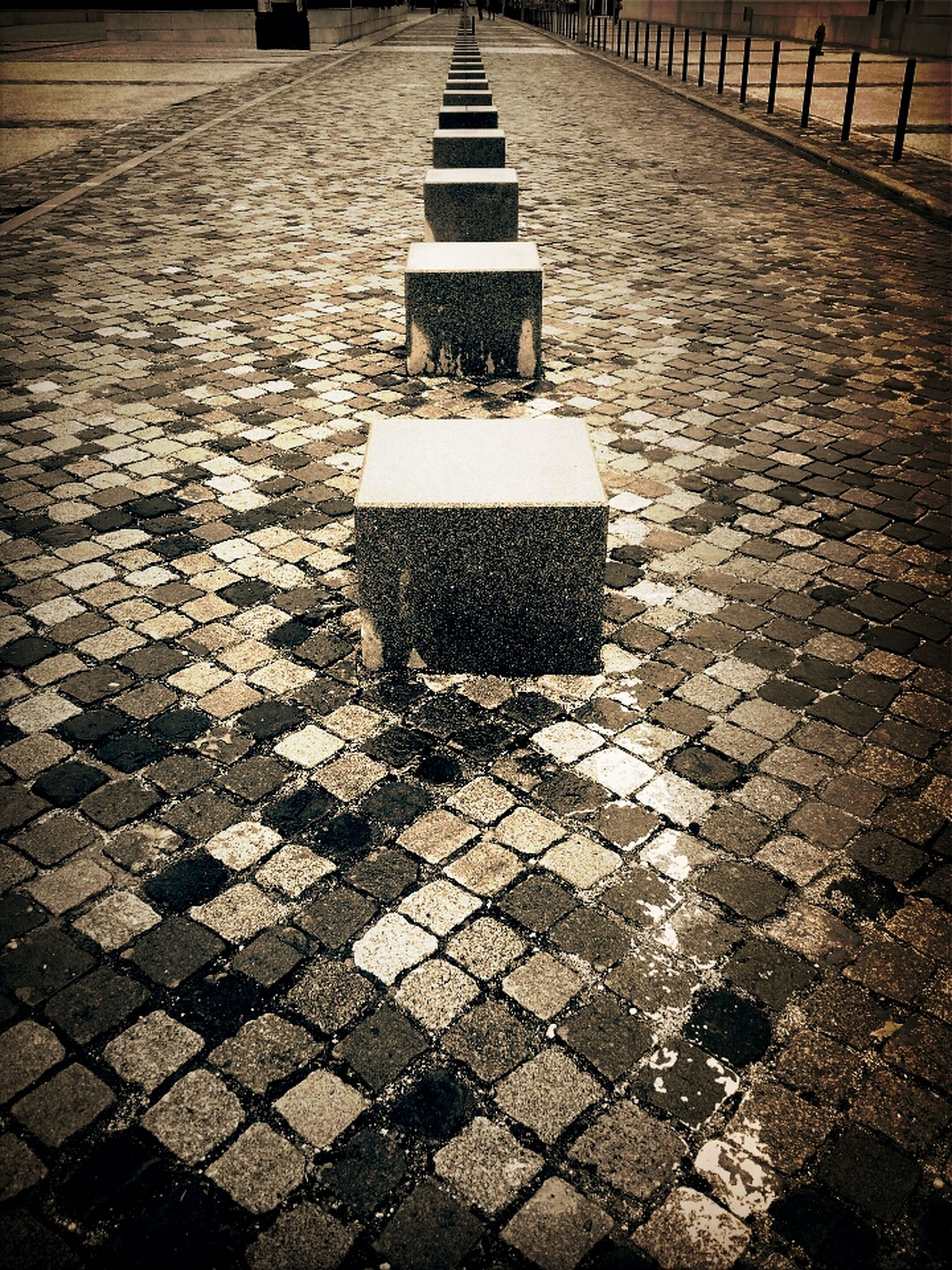 cobblestone, the way forward, street, paving stone, footpath, shadow, sunlight, diminishing perspective, sidewalk, road, asphalt, empty, high angle view, vanishing point, surface level, outdoors, walkway, day, road marking, pattern