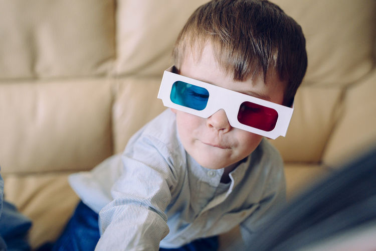 Portrait of boy wearing 3d glasses at home