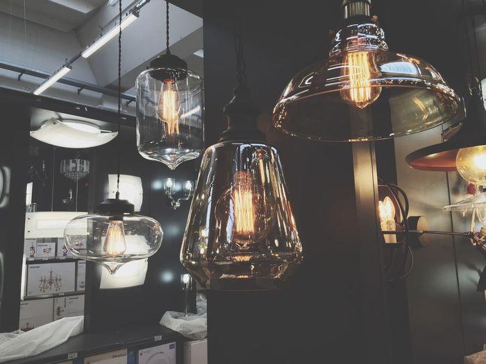 Close-up of illuminated light bulbs hanging
