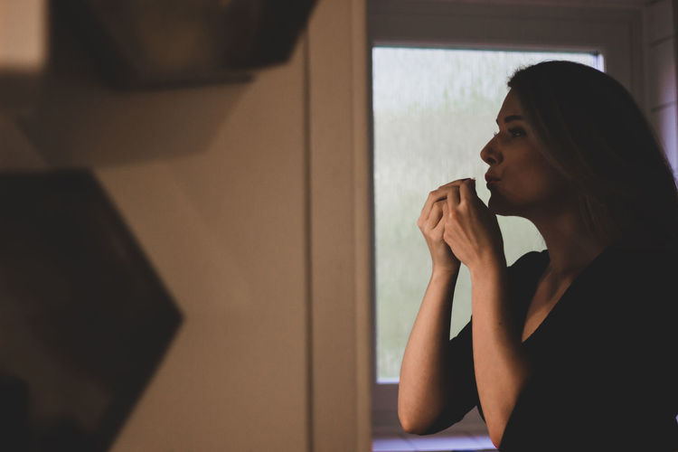 Portrait of woman looking away at home