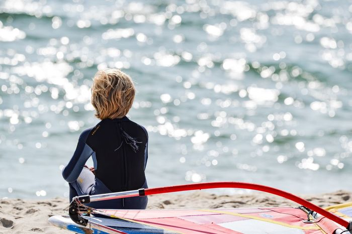 EyeEm Selects Rear View One Person Real People Water Outdoors Leisure Activity Sea Oar Day Nature Sport Child People Adventure Aquatic Sport One Woman Only Healthy Lifestyle Adult Nautical Vessel Blond Hair Surferboy