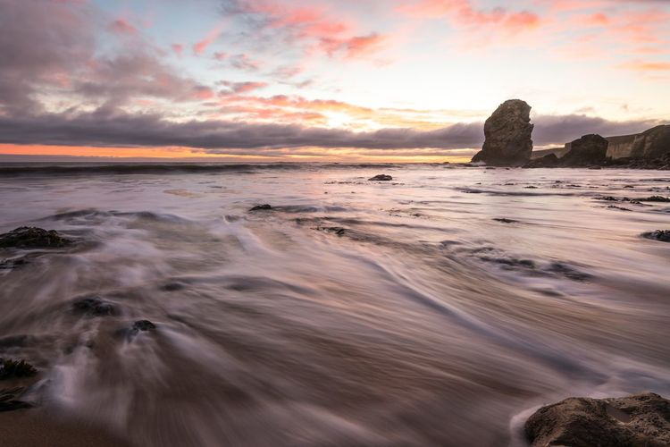 Marsden beach Nikon Nikonphotography EyeEm Masterclass Water Sea Sky Land Sunset Beach Scenics - Nature Beauty In Nature Cloud - Sky Tranquil Scene No People Horizon Motion Solid Rock - Object Rock Horizon Over Water Idyllic Tranquility Nature