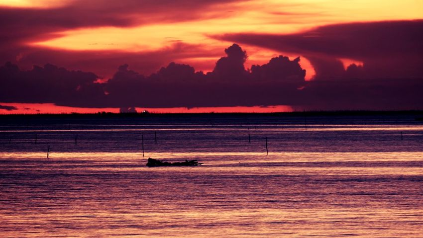 Sea on time. Water Sunset Sky Nautical Vessel Sea Transportation Mode Of Transportation Scenics - Nature Beauty In Nature Cloud - Sky Tranquility Silhouette Tranquil Scene Nature Idyllic Mountain Orange Color Travel Waterfront Outdoors