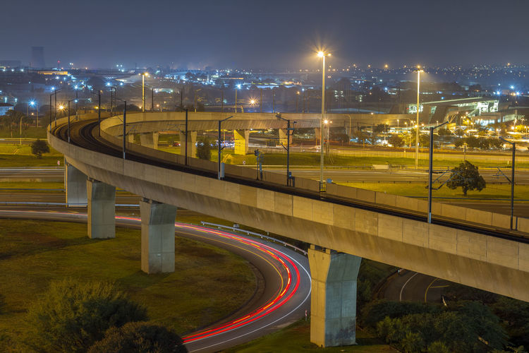 Highway Long Exposure Nightphotography Lights Architecture Night Transportation Illuminated Built Structure City Road Connection Bridge Motion No People Multiple Lane Highway Overpass Curve Leading Lines Building Exterior Street Street Light Bridge - Man Made Structure Light Trail City Life Speed Outdoors Cityscape