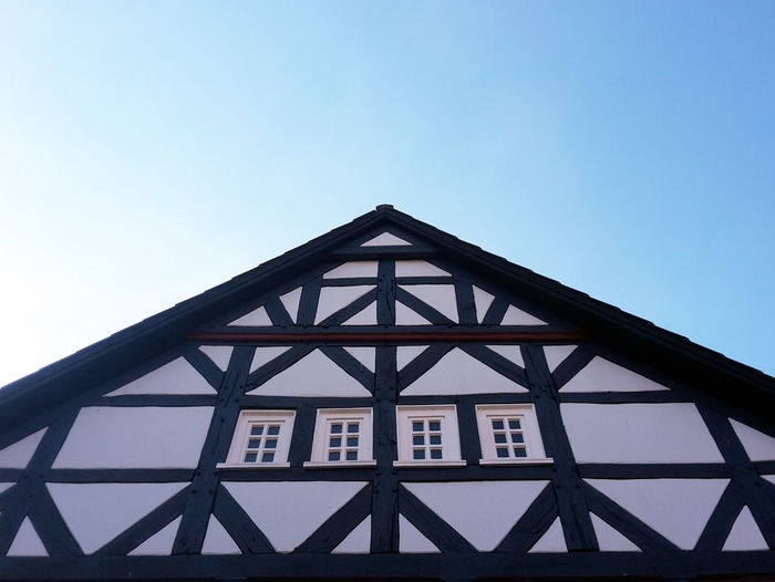 Low angle view of half-timbered house against clear sky