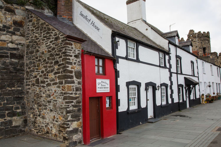 The smallest house in Great Britain in Conwy North Wales Architecture Built Structure Building Exterior Building Red Day Communication No People City House Text Outdoors Sign Residential District Nature Wall Footpath Street Entrance Door Smallest House In Conwy Smallest House In Great Britain Conwy Conwy Harbour