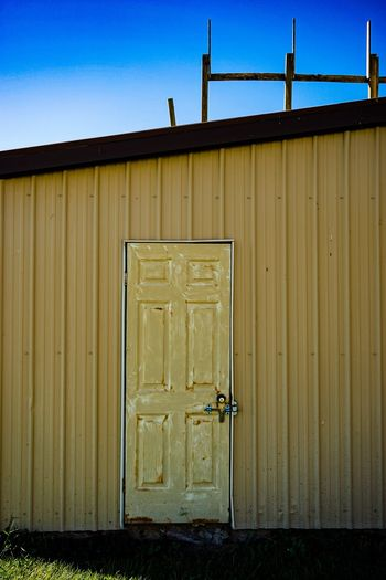Architecture Door Built Structure Building Exterior Closed House Blue Factory Façade Industry Day Outdoors Entrance Rural Scene Sky Exterior