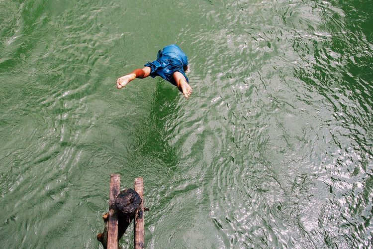High angle view of man diving into sea