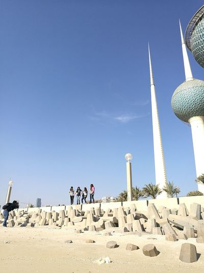 Blue Outdoors Clear Sky Dayshots Concretewalls Group Of People Kuwait Towers Lifestyles Looking At Camera Standing Together Friendship Bonding