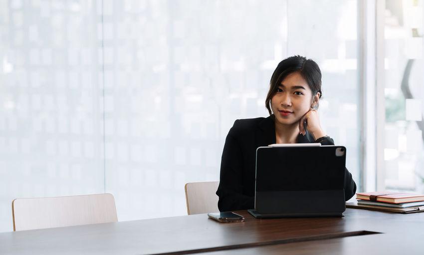Portrait of woman using smart phone