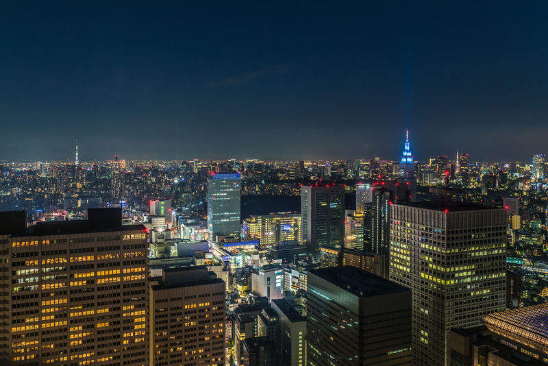 """Keep on moving As the night falls over Tokyo, I feel at home in this alien city and the amazing country I fell in love with. But I make no illusions, this is not where I belong. I need to keep on moving. (Nikon D810 24-70mm f/2.8 ƒ/4.5 28mm 1.6"""" iso 100) ASIA City Copy Space D810 Horizontal Japan Metropolitan Government Building Nikon Tokyo Architecture Building Exterior Built Structure Capital City Cityscape Crowded Illuminated Long Exposure Metropolis Modern Night No People Outdoors Sky Skyscraper Skytree Travel Destinations Urban Urban Skyline 東京都庁 Lost In The Landscape"""