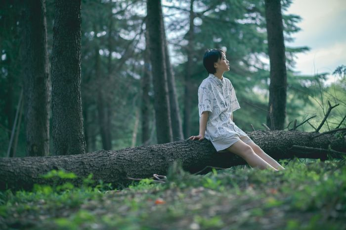 Tree Forest One Person Plant Land Young Adult Nature Side View Outdoors Young Women Lifestyles Real People Adult Women Tree Trunk WoodLand