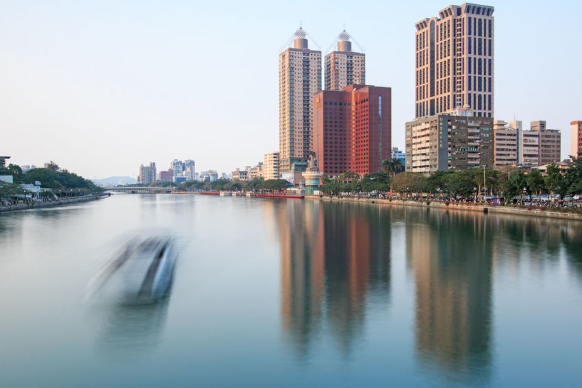 Kaohsiung, Taiwan - December 18,2014: Panoramic view of the Love River of Kaohsiung from the bridge on Wufu Road Architecture ASIA Buddha Building Building Exterior Built Structure China City Cityscape Iconic Buildings Kaohsiung Love River Modern Office Building Outdoors Reflection River Rock Sky Skyscraper Taiwan Tall - High Urban Skyline Water Waterfront