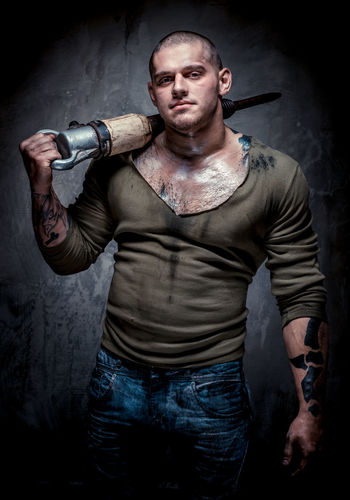 Muscular tattooed man with jackhammer posing over grey background Adult Athlete Athletic Bodybuilding Equipment Handsome Jackhammer Looking At Camera Male Man Masculinity Muscle One Person People Pneumatic Shaven Head Sportive Studio Shot