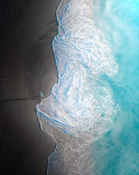 High angle view of snow on sea