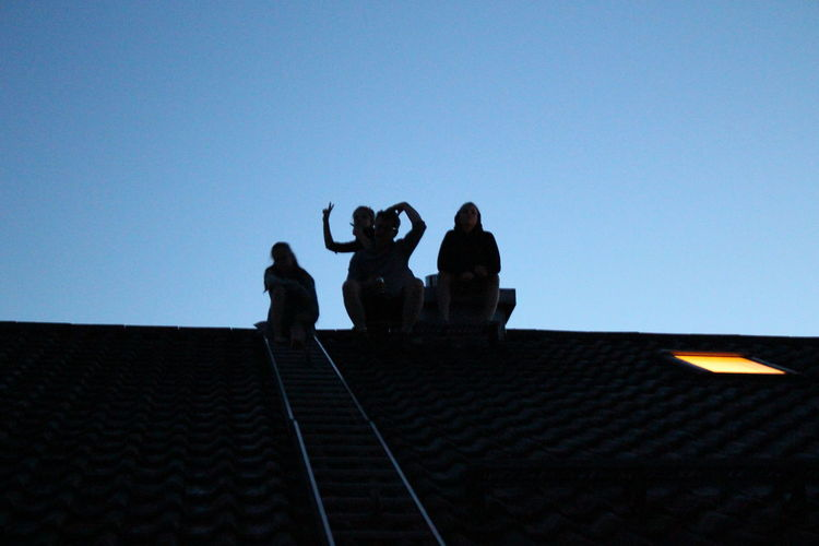 children in the dark Munich, Germany Adult Architecture Blue Building Exterior Built Structure Clear Sky Copy Space First Eyeem Photo Group Of People Leisure Activity Lifestyles Low Angle View Men Nature Outdoors People Real People Silhouette Sky Standing