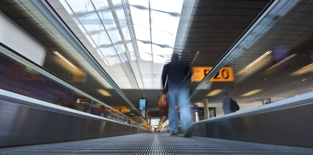 Conveyor Belt Travel Airplane Wing Blurred Motion Illuminated Indoors  Long Exposure Motion One Person Real People Speed Transportation